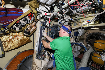 Preparing spacesuits to spacewalk