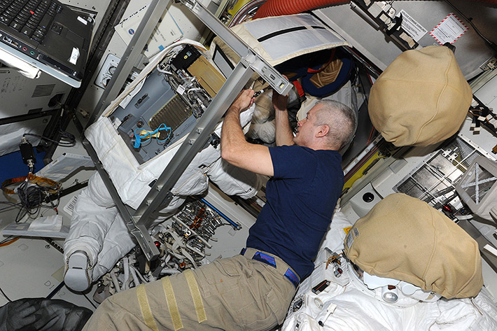 Steve Swanson repairs Space suit