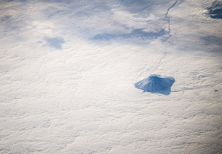Kamchatka. Lonely Volcano in the Sea of Clouds